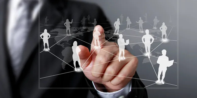 Person pointing at overlay graphics of people on positions around a map