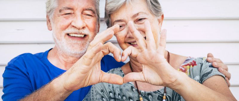 Senior couple making heart with hands